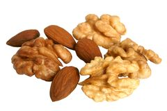 Almonds and walnuts. Isolated on the white background stock photo