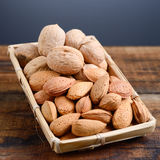 Almonds and walnuts Stock Photos
