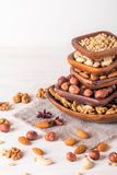almonds, walnuts, hazelnuts cashews and pine nuts in wooden bowl Stock Photography