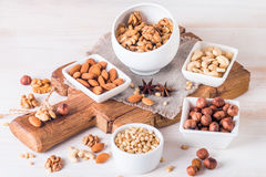 almonds, walnuts, hazelnuts cashews and pine nuts in wooden bowl Royalty Free Stock Photos