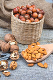 Almonds, walnuts and hazelnuts on an old rustic wooden background Royalty Free Stock Photography