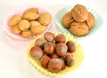 Almonds, Walnuts and Hazelnuts. Walnut, almonds and hazelnuts in paper cups Stock Photo