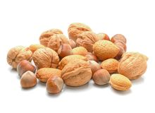 Almonds, walnuts and hazelnuts. On white Stock Photos