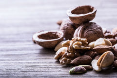 Almonds, walnuts and hazelnuts on wooden table. Stock Photo