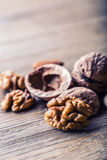 Almonds, walnuts and hazelnuts on wooden table. Stock Photos
