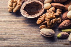 Almonds, walnuts and hazelnuts on wooden table. Royalty Free Stock Image