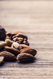 Almonds, walnuts and hazelnuts on wooden table. Royalty Free Stock Photo