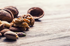 Almonds, walnuts and hazelnuts on wooden table. Stock Image