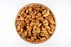 Almonds and walnuts in a round basket stock images