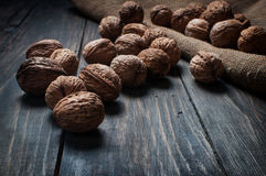 Almonds, walnuts on wooden table. assortment of nuts. Royalty Free Stock Image