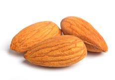 Almonds on white Stock Photos