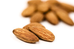 Almonds on white. Pile of almonds isolated on white Stock Photos