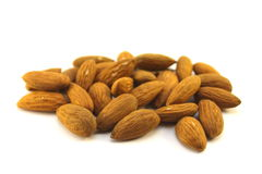Almonds on a white background. Close-up Stock Images