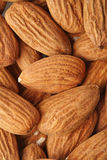 Almonds on white background - close-up Stock Images