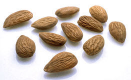 Almonds. On white background with reflection Stock Photo