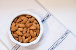 Almonds in White Bowl Royalty Free Stock Image