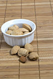 Almonds in white bowl Royalty Free Stock Images