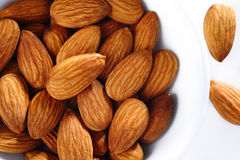 Almonds in white bowl Stock Photography