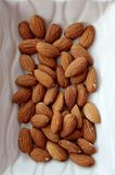 Almonds. In a white bowl Royalty Free Stock Photography