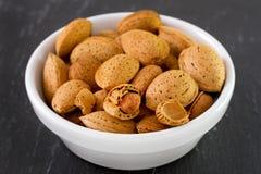 Almonds on white bowl Royalty Free Stock Photos