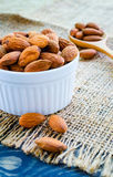 Almonds in white bowl on hemp Stock Photography