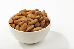 Almonds in a white bowl Stock Images