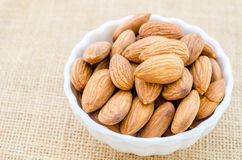 Almonds in white cup. Royalty Free Stock Photo