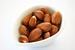 Almonds. In a white elliptic bowl Royalty Free Stock Photo