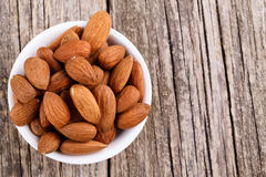 Almonds on a white plate. Royalty Free Stock Photos