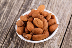 Almonds on a white plate. Stock Image