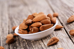 Almonds on a white plate. Stock Images