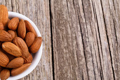 Almonds on a white plate. Stock Photos