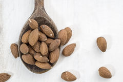 Almonds, white wooden table background Stock Image