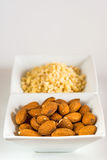 Almonds, whole and minced Royalty Free Stock Photos
