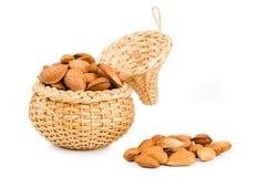 Almonds in a wicker basket Stock Photo