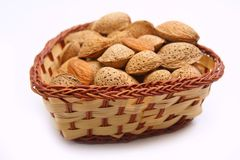 Almonds in wicker bowl Stock Photography