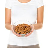 Almonds - woman showing raw almond bowl Stock Images