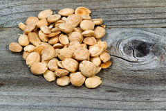 Almonds on wood Stock Photography