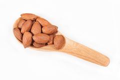 Almonds on wood spoon Royalty Free Stock Photography