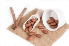 Almonds in wood spoon Stock Photos