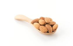 Almonds with wood spoon Stock Photography