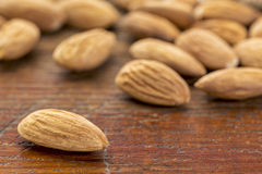 Almonds on wood table Stock Photos