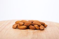 Almonds. On wood on white background stock images