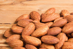Almonds on wooden  background. Royalty Free Stock Photo