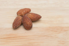 Almonds on wooden background. Stock Photography