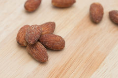 Almonds on wooden background. Royalty Free Stock Photography