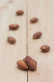 Almonds on wooden background. Stock Photos