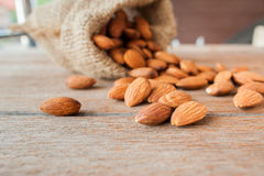 Almonds  on wooden background Royalty Free Stock Photos