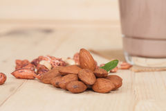 Almonds  on wooden background Royalty Free Stock Photography