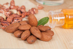 Almonds  on wooden background Royalty Free Stock Photo